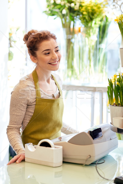 smiling florist woman at flower shop cashbox Stock photo © dolgachov