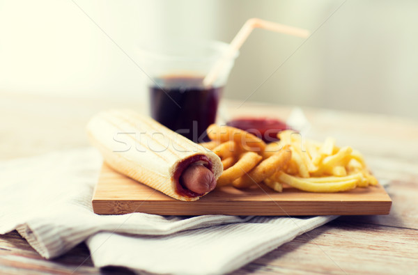 Stock photo: close up of fast food snacks and drink on table