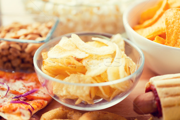 close up of crunchy potato crisps in glass bowl Stock photo © dolgachov