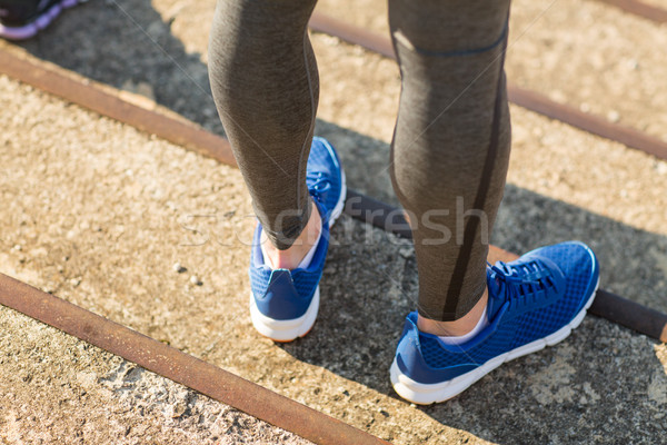 close up of sporty man legs in shoes on stairs Stock photo © dolgachov