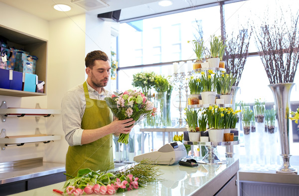 florist man making bunch at flower shop Stock photo © dolgachov
