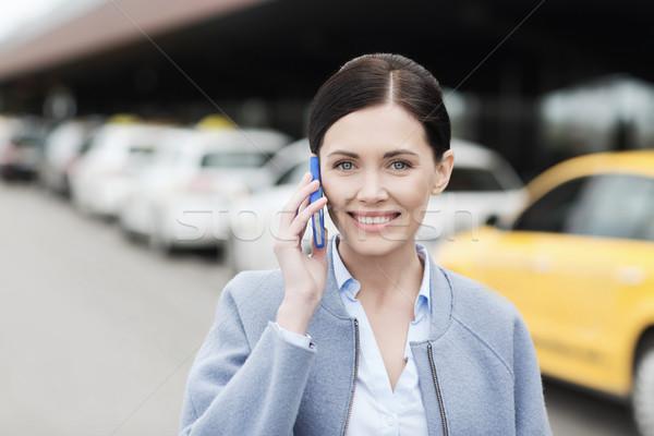 Gülümseyen kadın taksi şehir seyahat iş gezisi Stok fotoğraf © dolgachov