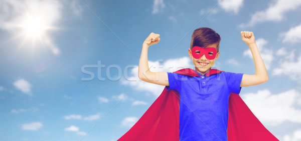 boy in red superhero cape and mask showing fists Stock photo © dolgachov