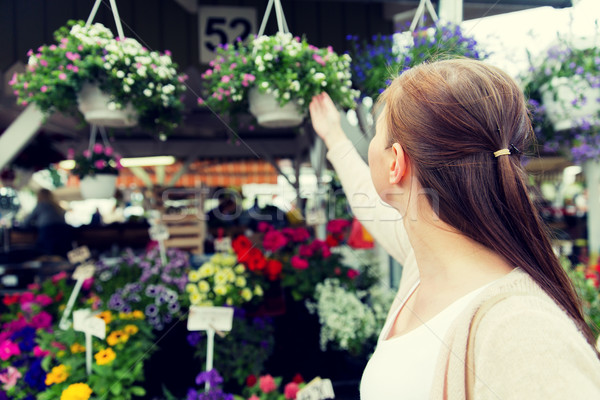 woman choosing flowers at street market Stock photo © dolgachov