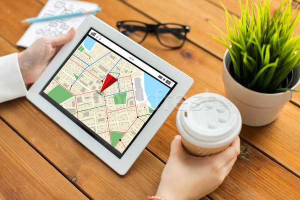 close up of woman with navigtor map on tablet pc Stock photo © dolgachov