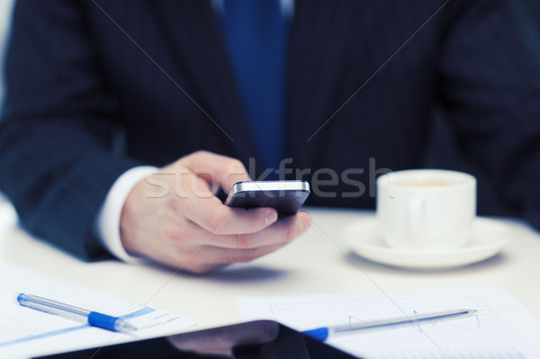businessman with smartphone reading news Stock photo © dolgachov