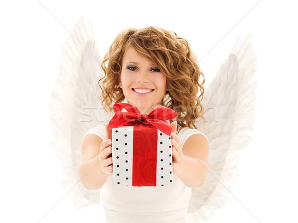 Boldog fiatal nő angyalszárnyak ajándék doboz emberek ünnepek Stock fotó © dolgachov