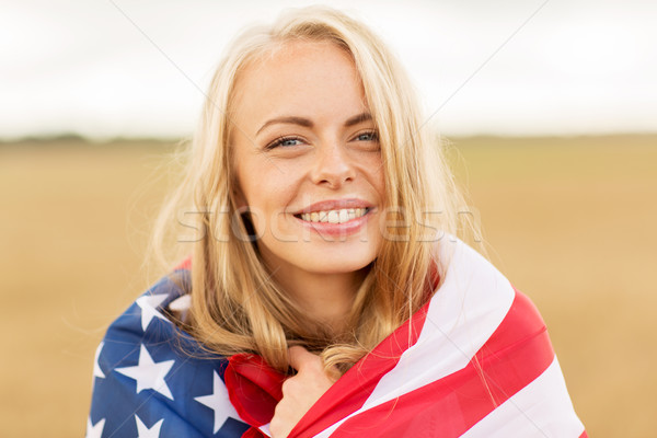 happy woman in american flag on cereal field Stock photo © dolgachov