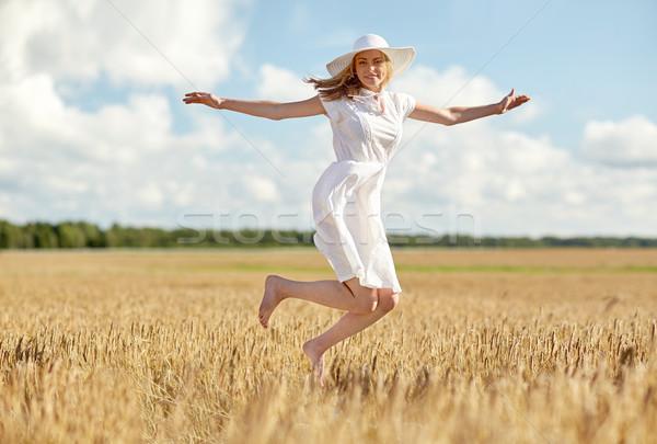Stok fotoğraf: Mutlu · genç · kadın · atlama · tahıl · alan · mutluluk