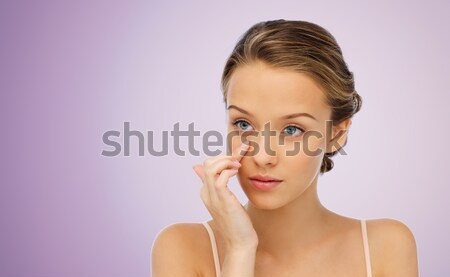 face of beautiful asian woman with golden ring Stock photo © dolgachov