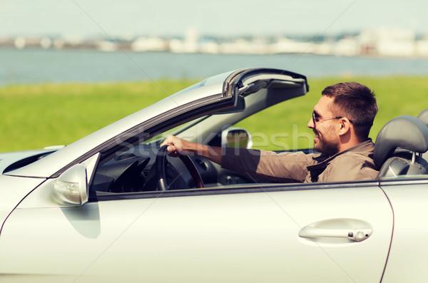 happy man driving cabriolet car outdoors Stock photo © dolgachov