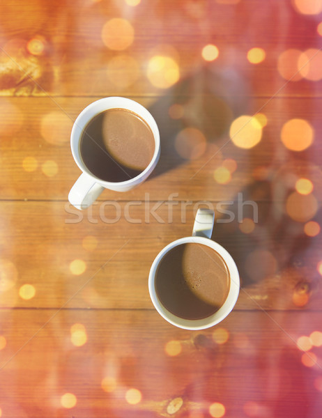 cups of hot chocolate or cocoa drinks on wood Stock photo © dolgachov