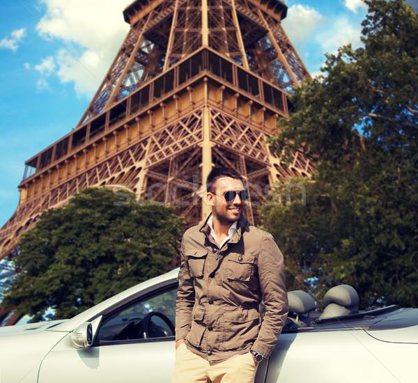 Boldog férfi cabrio autó Eiffel torony Stock fotó © dolgachov