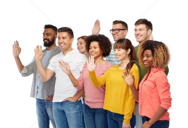 international group of happy people waving hand Stock photo © dolgachov