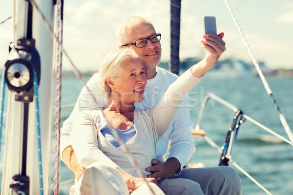 Idős pár elvesz vitorla csónak jacht vitorlázik Stock fotó © dolgachov