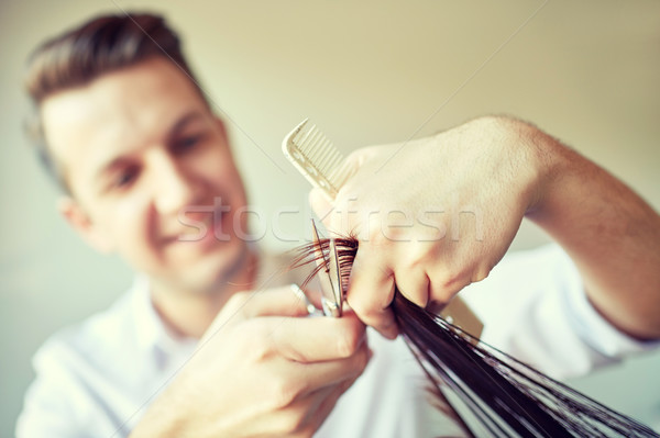 stylist with scissors cutting hair tips at salon Stock photo © dolgachov