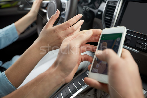 happy man and woman with smartphone driving in car Stock photo © dolgachov