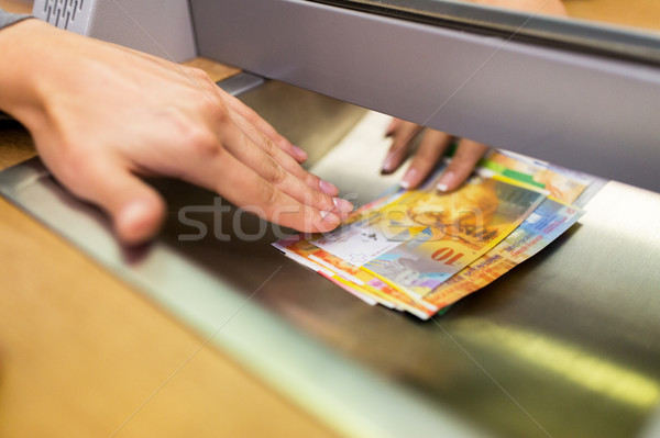 clerk giving cash money to customer at bank office Stock photo © dolgachov