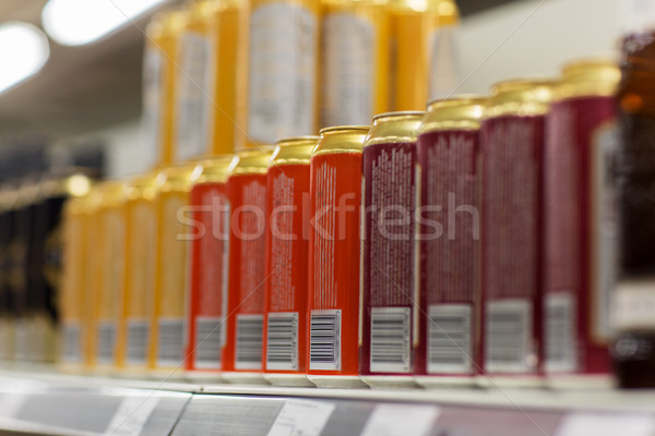 close up of beer or cider cans at liquor store Stock photo © dolgachov