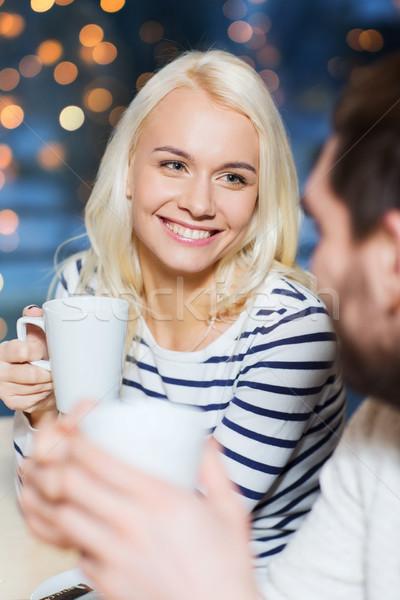 Feliz Pareja reunión potable té café Foto stock © dolgachov