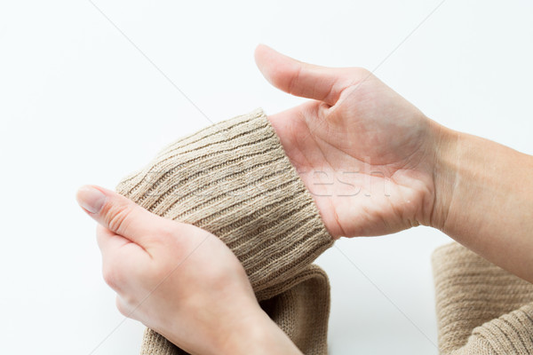 close up of hands with sweater sleeve Stock photo © dolgachov