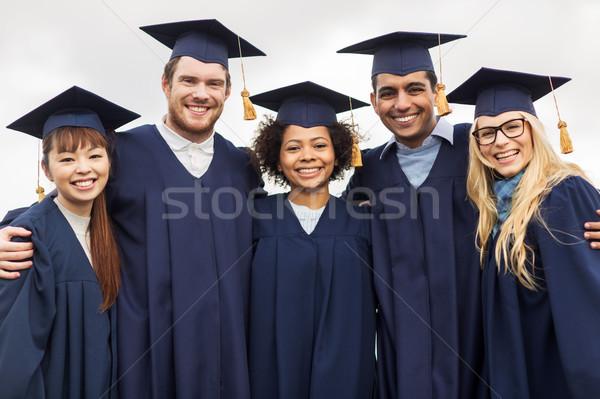 Feliz estudiantes solteros educación graduación personas Foto stock © dolgachov