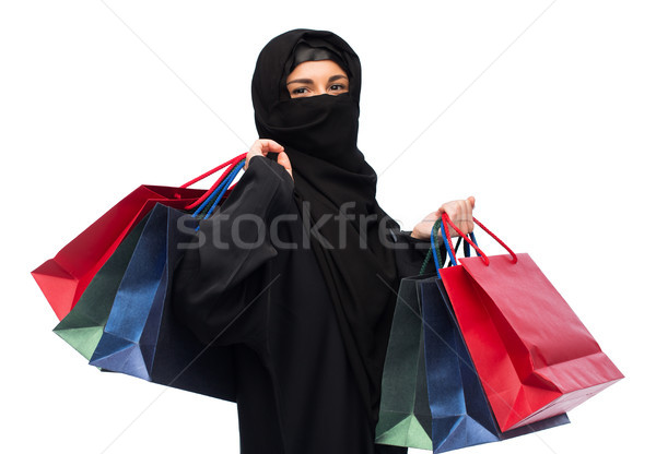 muslim woman in hijab with shopping bags Stock photo © dolgachov
