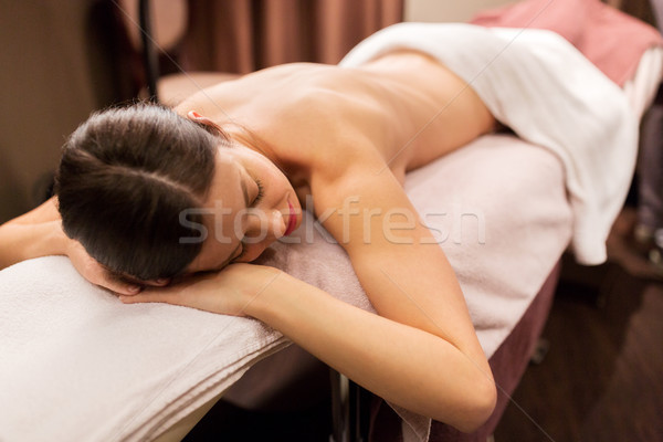 young woman lying at spa or massage parlor Stock photo © dolgachov