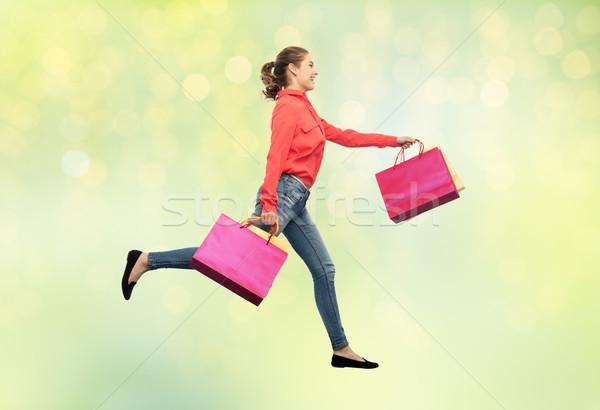 Souriant jeune femme courir vente mouvement Photo stock © dolgachov