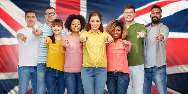 Internationaux groupe de gens pointant diversité choix Photo stock © dolgachov