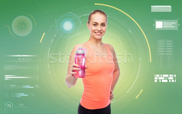 happy sportive young woman with water bottle Stock photo © dolgachov