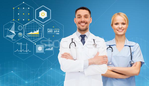 Lächelnd Ärzte Charts Gesundheitswesen Menschen Kardiologie Stock foto © dolgachov