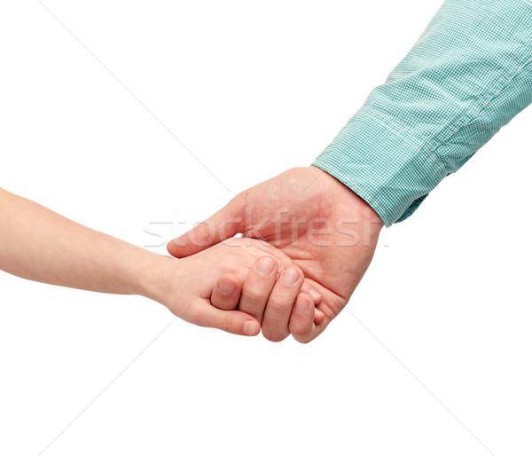 Heureux père enfant mains tenant famille enfance Photo stock © dolgachov