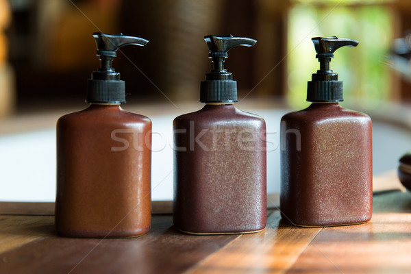 bottles with liquid soap or lotion at bathroom Stock photo © dolgachov