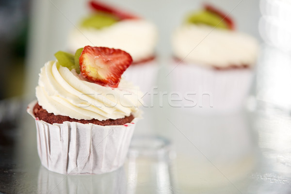 cupcake with cream and strawberry at sweet shop Stock photo © dolgachov