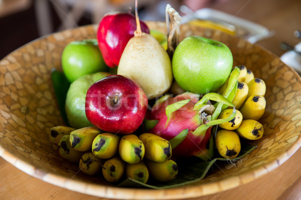 Still life exotique tropicales fruits bol alimentaire Photo stock © dolgachov