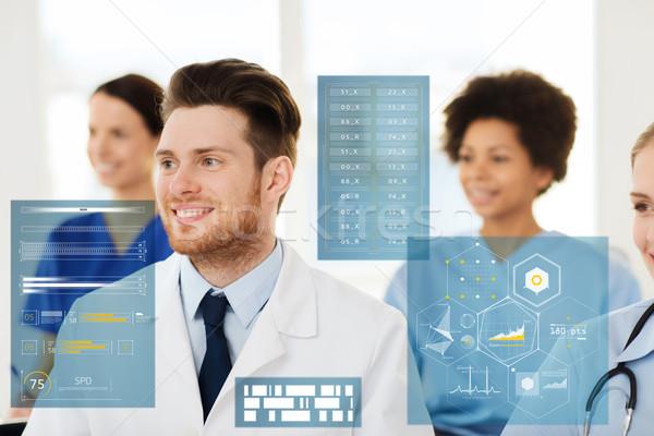 Boldog orvos csoport kórház gyógyszer egészségügy Stock fotó © dolgachov