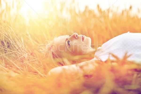 Fiatal nő gabonapehely mező álmodik természet nyár Stock fotó © dolgachov