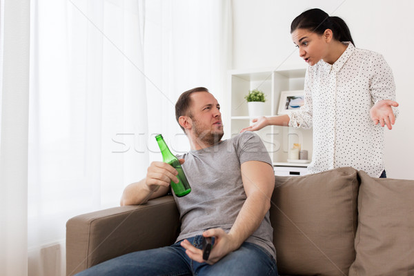 couple having argument at home Stock photo © dolgachov