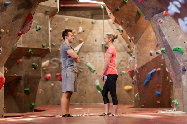 man and woman talking at indoor climbing gym Stock photo © dolgachov