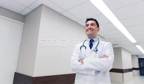 smiling doctor in white coat at hospital Stock photo © dolgachov