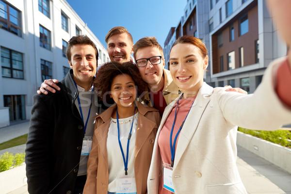 Takım konferans rozetler şehir iş Stok fotoğraf © dolgachov