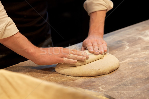 chef or baker cooking dough at bakery Stock photo © dolgachov