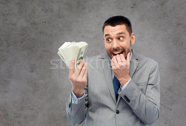 Hebzuchtig zakenman amerikaanse dollar geld zakenlieden Stockfoto © dolgachov