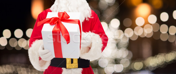 close up of santa claus with christmas gift Stock photo © dolgachov