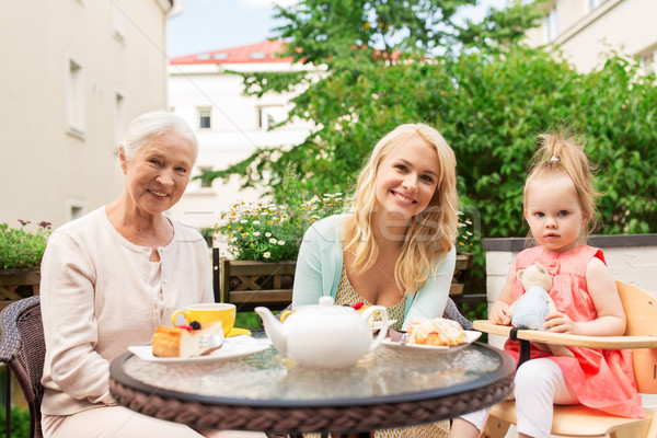 mother, grandmother and granddaughter at cafe Stock photo © dolgachov