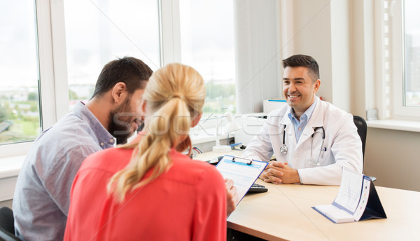 couple visiting doctor at family planning clinic Stock photo © dolgachov