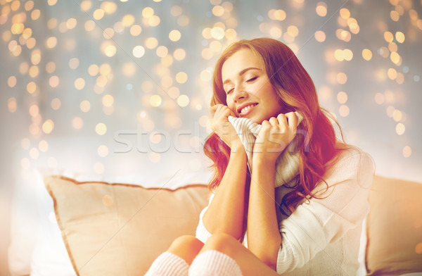 happy young woman in warm pullover at home Stock photo © dolgachov