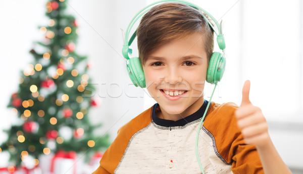 Nino auriculares Navidad ninos Foto stock © dolgachov