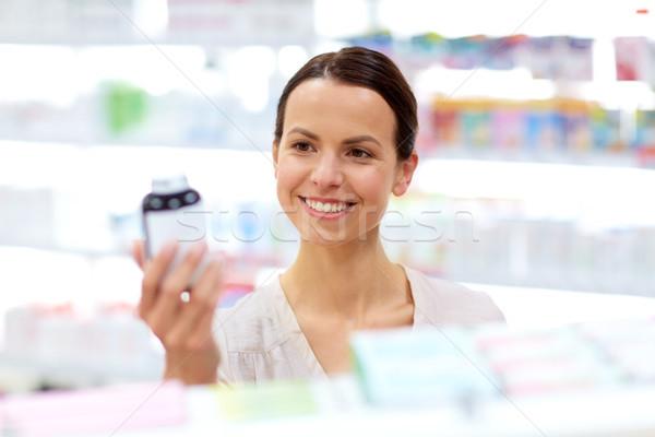 female customer choosing drugs at pharmacy Stock photo © dolgachov